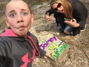 Graffito-tagging Jamey's gravestone.